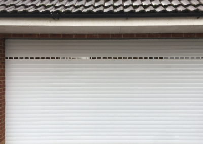 77mm White Insulated Roller door with Vision Windows